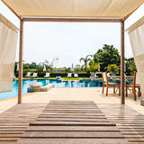 Sunbed chair and swimming pool Stock Photo