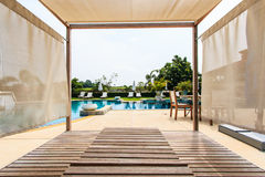 Sunbed chair and swimming pool. In relax time Stock Photos