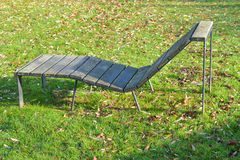 Sunbed, chaise longue in the park. Sunbed, wood chaise longue in the park stock images