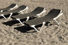Sunbed closeup on beach of sepia color Stock Photography