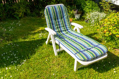 Sunbed in the garden during summer. Colourful sunbed in the garden during summer Royalty Free Stock Photography