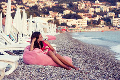 Sunbed. Girl on the sun loungers on the beach Royalty Free Stock Image