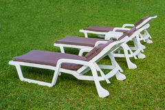 The sunbed on the green grass Royalty Free Stock Image