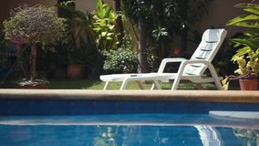 Sunbed lounger near the swimming pool. Tropical paradise. 1920x1080 stock video
