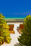Sunbed on Maldives beach Royalty Free Stock Images
