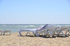 Sunbed near sea on sand Royalty Free Stock Photography