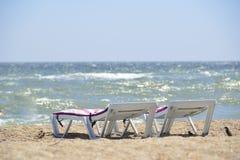 Sunbed near sea on sand Stock Photo