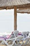 Sunbed near sea on sand. White sunbed near sea on sand ( summer holiday Royalty Free Stock Photography