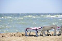 Sunbed near sea on sand Royalty Free Stock Image