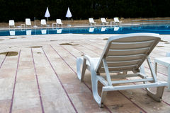 Sunbed near Swimming Pool Stock Photo