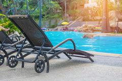 Sunbed near swimming pool Royalty Free Stock Images