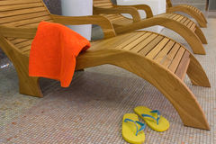 Sunbed with orange towel Stock Photo