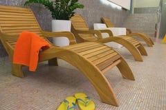 Sunbed with orange towel Royalty Free Stock Photo