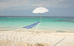 Sunbed and parasol on the beach Royalty Free Stock Image
