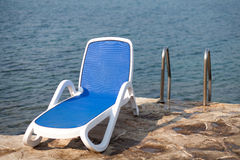 Sunbed at pier Royalty Free Stock Image