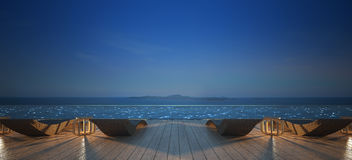 Sunbed on pool deck in the night sky Stock Images