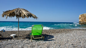 Sunbed on the sandy beach. Sunbed on the beach near . Taken in Crete 2011 stock image