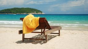 Sunbed on sandy beach Royalty Free Stock Images
