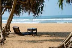 Sunbed on sandy beach Royalty Free Stock Photos
