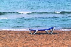 sunbed on the sandy beach Stock Image