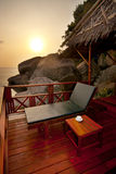 Sunbed on a terrace. Sunset sunbed on wooden terrace with coffee table Stock Photo