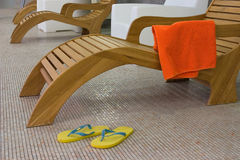 Sunbed with towel  and yellow Stock Photo