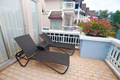 Sunbed on a tropical terrace. Balcony Royalty Free Stock Images