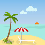 Sunbed with an umbrella on the beach Royalty Free Stock Photo