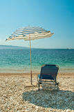 Sunbed and umbrella on the beach Stock Photography