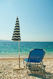 Sunbed and umbrella on the beach Stock Photos