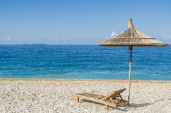 Sunbed and umbrella at beach Royalty Free Stock Photos