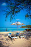 Sunbed and umbrella on beautiful tropical beach Stock Image