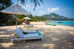 Sunbed and umbrella on beautiful tropical beach Stock Photo