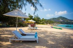Sunbed and umbrella on beautiful tropical beach Stock Photography