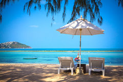 Sunbed and umbrella on a beautiful tropical beach Royalty Free Stock Image