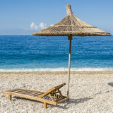 Sunbed and umbrella at tropical beach Royalty Free Stock Image