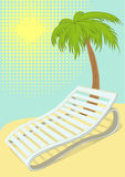Sunbed under palm tree on tropical beach Royalty Free Stock Image