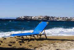 Sunbed. Waves covered the empty beach, chaise-longue, sunbed Stock Image