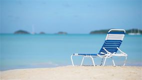 One chaise-longue on white tropical caribbean beach. Sunbed on white tropical caribbean beach stock video