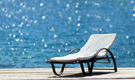Sunbed on wooden deck Royalty Free Stock Photo