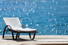 Sunbed on wooden deck Stock Photos