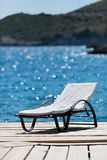 Sunbed on wooden deck Stock Photography
