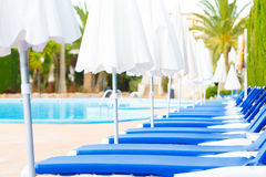 Sunbeds around the pool Royalty Free Stock Photography