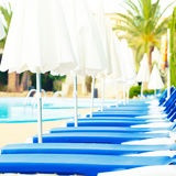 Sunbeds around the pool Royalty Free Stock Images