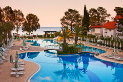 Sunbeds around pool in hotel of Kemer, Turkey. Stock Photos