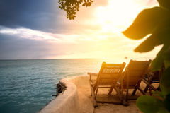 Sunbeds on artificial beach with a beautiful view royalty free stock images