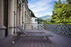 Sunbeds on the balcony with beautiful view of the mountains on t Stock Photo