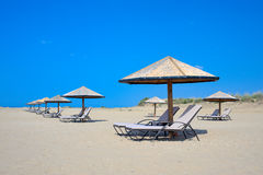 Sunbeds on the beach Royalty Free Stock Photography
