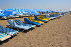 Sunbeds on the beach Stock Photography