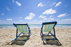 Sunbeds on the beach Royalty Free Stock Photo